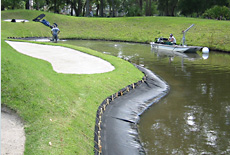 Geotube used to create desired water hazard slope
